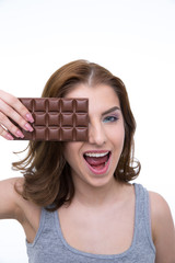 Funny woman covering her eye with chocolate bar