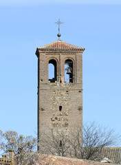 Tower of catholic church with four slopes of water