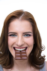 Happy woman biting in a chocolate tablet