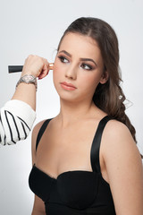 Makeup session with beautiful young brunette woman