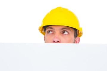Handyman hidden behind blank board
