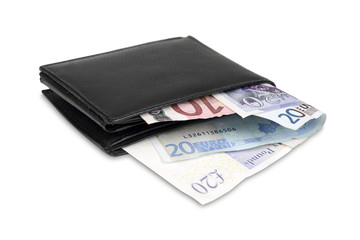Wallet with euro and pound banknotes with clipping path.
