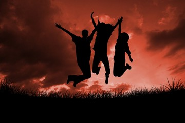 Composite image of silhouette of people jumping