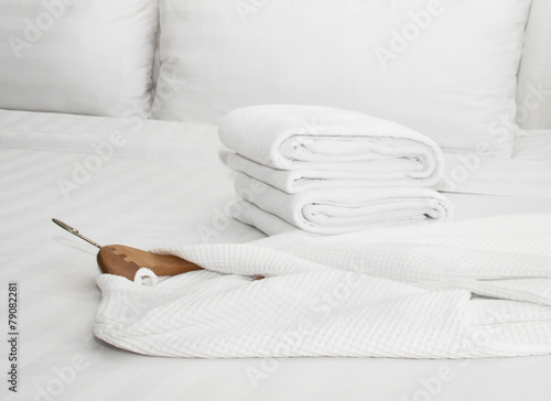 white bathrobe on the bed - 79082281