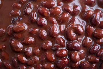 Close view of black beans in chili sauce