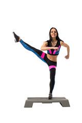 Vigorous athletic girl exercising on stepper
