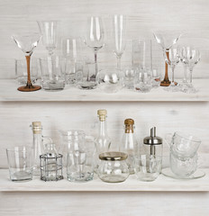Various glassware collection on wooden shelves
