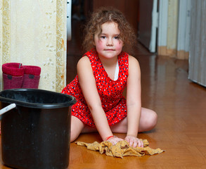 Girl cleaning the floor