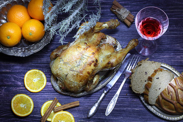 The hen a grill submitted with oranges, bread and red wine, a st