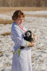 Veterinarian with kid on his hands