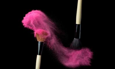 powderbrush on black background with blue powder splash