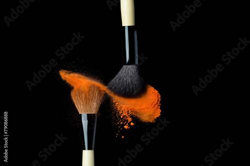 powderbrush on black background with blue powder splash - 79086888