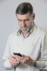 Middle aged man looking at his phone