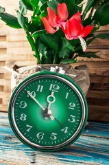 symbol of spring green clock and blossoming flower