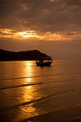 sunset at sea and fishing boat