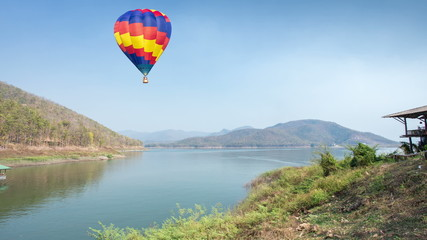 Colorful hot air balloon fly over the lake, timelapse