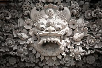 Stone daemon sculpture