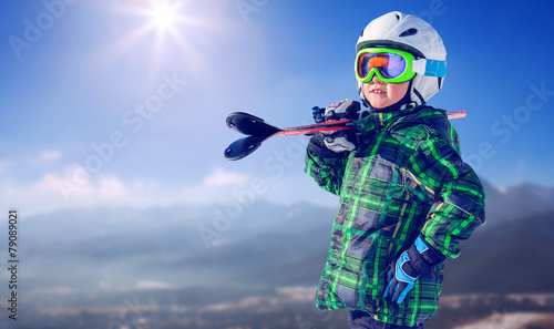 Boy in full ski equipment on the mountain view - 79089021
