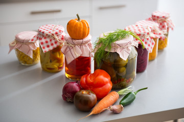 Closeup on jars of pickled vegetables on table