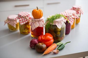 Closeup on jars of pickled vegetables on table