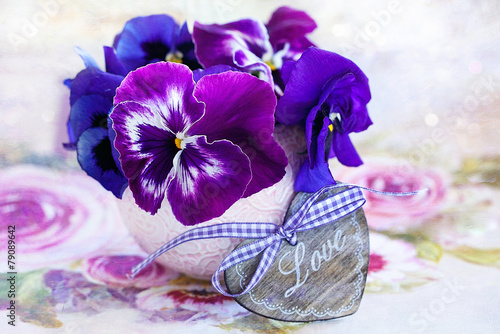 Tuinposter Pansies Photo of a beautiful purple pansy flowers and wooden heart.