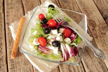 Bowl with fresh vegetable salad