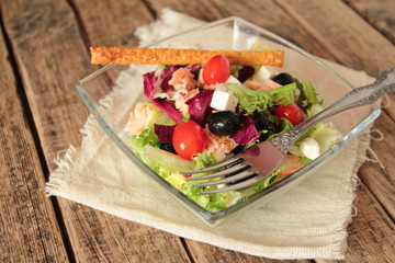 Fresh vegetable salad with olives and tomatoes