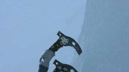 using ice climbing axes close up