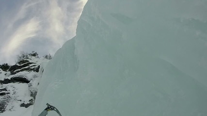 climbing steep frozen waterfall pov