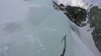 ice climbing axes pov slow motion
