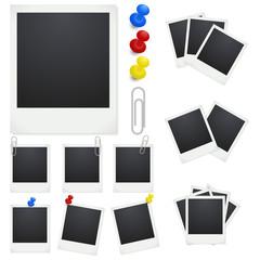 Set Polaroid photo frames with clips and thumbtacks on white