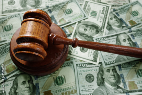 Judge gavel on cash - 79090638