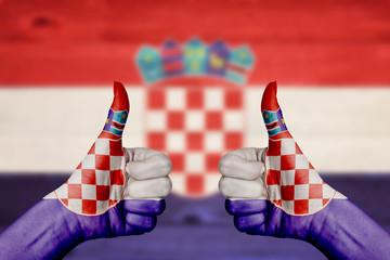 Croatia flag painted on female hands thumbs up