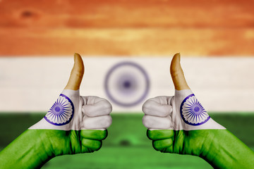 India flag painted on female hands thumbs up