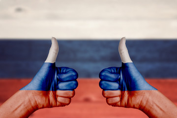 Russia flag painted on female hands thumbs up