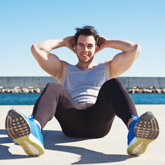 Happy athlete doing sport exercise outdoors