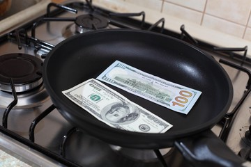 Money in a pan