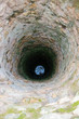 Very deep old water well with grid. - 79091846