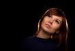 Portrait of a beautiful pensive redhead girl