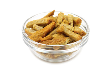 rye crackers in glass bowl on a white background