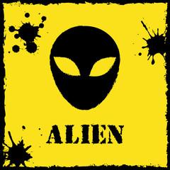 Vector alien logo on yellow background