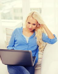 woman with laptop computer at home