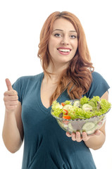Happy woman eating salad. Woman keeping a diet with green salad