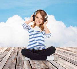 happy girl with headphones listening to music