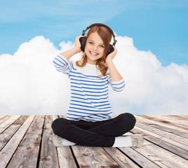 happy girl with headphones listening to music