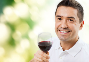 happy man drinking red wine from glass