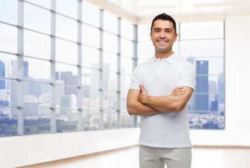 smiling man in white t-shirt over office or home
