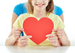 close up of girl and mother holding red heart