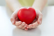 Leinwanddruck Bild - close up of child hands holding red heart