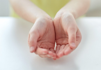 close up of child cupped hands
